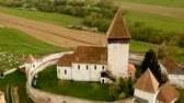 стена : Aerial view of Hosman fortified church in Transylvania, Romania