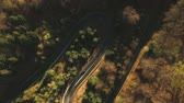curva : Aerial view of the mountain road, at sunrise Vídeos