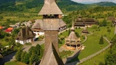 church : Aerial view over Barsana Monastery, Maramures - Romania. Wooden church UNESCO world heritage site
