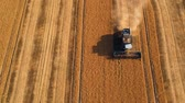 семя : Summer view of combine harvester machine, in the romanian fields. Aerial view of harvesters Стоковые видеозаписи