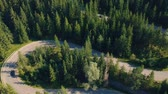 autumn forest : Aerial view of cars driving on mountain road Stock Footage
