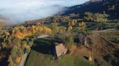 nevoeiro : Aerial view above the romanian village, in autumn Vídeos