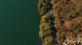 Cars driving on mountain road. Aerial view of Danube Gorge, Romania, in autumn