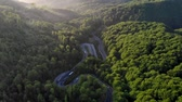 temporadas : Aerial view of cars driving on a curvy mountain road