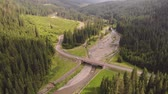 Aerial view of Transalpina mountain road, in summertime . Aerial view of a curved winding road