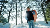 tobogganing : Portrait of a boy with a sled in the hands of winter activities for children, a happy child is preparing sehat the hills on sleds Stock Footage