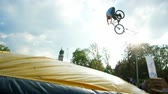 bike ride : Sofia, Bulgaria - 15 September 2016: jumping on trampoline with bike, extreme sports, making tailwhip on bmx, dangerous tricks on bike, ride bicycle, traumatic in Sofia 15 September 2016.