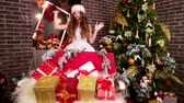 brinquedos : Happy girl found gifts, Young girl in room with holiday boxes, Prepares gifts for Christmas, On New Years Eve, surprise from Santa Claus near Christmas tree, Assistant Santa Claus puts presents
