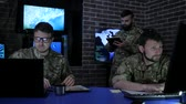командир : warriors in uniform, military base, working in digital tablet, sketch pad and laptop, discussing assault, security service and tracking terrorists, on background display screens, War center