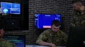отправка : professionals soldiers in uniform, in field headquarters, Cyber war strategy, attack security virus infection, satellite surveillance monitor screen, on background monitor and employees, War center