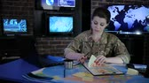 commander : portrait officer woman in military base, in system control center, military control and security service, in laptop system tracking terrorists, on background multiple displays and world map