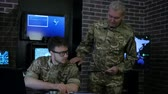 recon : wise commander indicates soldier on map, discussing battle strategy, security service, team security personnel working in busy system control room, control apartment, on war base, Stock Footage
