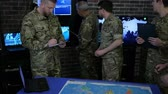 оператор : team military IT professionals people in uniform, control apartment, security service, view world map, on Briefing in monitoring room, on manages station on war base, military control