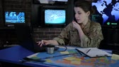 campo de batalha : portrait woman soldier speaks by mobile phone, cyber safety, technical control, tracking system, military staff, attack and security, control center, war base, IT war, working process