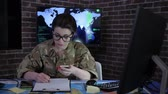 отправка : portrait female soldier with mobile phone, control center, war base, IT war, working process, cyber safety, technical control, tracking system, strategy warfare, field headquarters, military staff, attack and security Стоковые видеозаписи