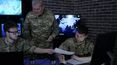 recon : military headquarters, security service, commander in uniform in monitoring room on war base, group military IT professionals manages station, people beside computer and monitor screen