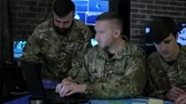 отправка : employees security personnel work with digital tablet and laptop, discussing battle strategy, security service, working in busy system control room, control apartment, on war base