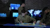 tática : cyber safety, discussing battle strategy holding digital tablet, command IT specialists, briefing, on background monitor, laptop, computer, on military headquarter or war base, security service, Vídeos