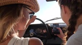 сотовый телефон : girlfriends make selfie photo on mobile in retro car at background sea, Happy together traveling, girls into car does selfi at gadget in sunlight, young womans makes pictures on phone sitting in auto