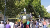 harcias : Kherson, Ukraine 24 August 2017: lot of people near military machine on street at city in Kherson, 24 August 2017 in summer