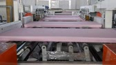 yalıtım : conveyor line with styrofoams in motion, industry of foam plastic at large factory