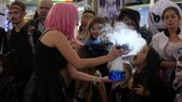 peruca : Kherson, Ukraine 31 October 2017: artificial smoke in girl hands for adults and childrens at shopping center on celebration halloween in Kherson, 31 October 2017.