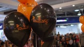carnívoro : helium balloons with the inscription happy halloween, black and orange festive balloons for design of hall
