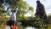 mere : rest, crucian on fishing rod into hands of grandpa with boy at water channel on nature