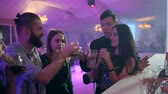 bar counter : young people with colored alcoholic beverages make a toast and have fun near the bar stand in nightclub on party Stock Footage