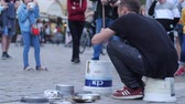 knocking : Wroclaw, Poland 12 May 2018: drummer perform on a simple bucket and dishes on street in front of the audience of people in Wroclaw, 12 May 2018.