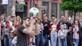stunt : Wroclaw, Poland 12 May 2018: Freestyler turns soccer ball and entertains crowd of townspeople on street in Wroclaw, 12 May 2018.