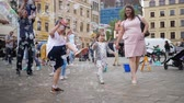 varinha : Wroclaw, Poland 12 May 2018: soap bubble day, cheerful child playing with bubbles in air on town street on festivity in Wroclaw, 12 May 2018.