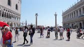 marco : Venice, Italy 19 May 2018: tour of Europe, people walking on background Columns of St. Mark and St. Theodore in Venice, 19 May 2018. Stock Footage