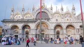 marco : Venice, Italy 19 May 2018: tourists walk near St. Marks Cathedral on famous square in Venice, 19 May 2018.