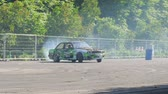 área de trabalho : Kiev, Ukraine 23 May 2018: extreme hobby, car performs drift and slides along asphalt into smoke on open air in Kiev, 23 May 2018.