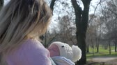 sling : happy motherhood, smiling mum with toddler spends time on open air in holiday close-up Stock Footage