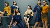 posh : fashion poses, female models posing on a background of dark wall in studio on photo shoot