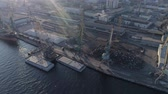 recyclable : cargo port with cranes in backlight, drone view of industrial ship and pile of metal is ready for transportation by water