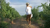 circling : grape crop, happy rural couple hugs at meeting during harvest season at vineyard in autumn day