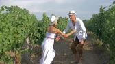 şarapçılık : rural love, young farmer circling girl into arms at vineyard in harvest season on sunny day Stok Video