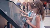 sensorial : modern childhood, nice kids uses interactive touchscreen display For search best route at shopping center