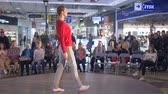 подиум : KHERSON, UKRAINE - OCTOBER 20, 2018: model in pajama and white socks defiles the catwalk during a fashion show on background of audience