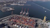 odessza : ODESSA, UKRAINE - OCTOBER 17, 2018: drone view of trading port industry with containers and lifting cranes for loading and unloading of vessel on Black Sea quayside
