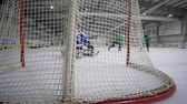 вратарь : KHERSON, UKRAINE - OCTOBER 17, 2018: hockey scoring, goalie with hockey stick falls and missed puck from opponent into goal on ice rink
