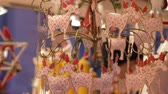 víkend : HEIDELBERG, GERMANY - DECEMBER 12, 2018: New Year toys, a lot of toy deer with a Christmas pattern on shop window in the shop