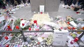 fotografando : STRASBOURG, FRANCE - DECEMBER 18, 2018: memorial with lots of flowers and candles, consequences of terrorist attack Stock Footage