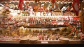 сувениры : STRASBOURG, FRANCE - DECEMBER 18, 2018: Christmas souvenir shop, lot of New Years presents and toys for tourists on bright store counter close-up