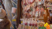 glaze : HEIDELBERG, GERMANY - DECEMBER 12, 2018: tourists woman with baby in arms considering beautiful tasty Christmas gingerbread at street shop close-up