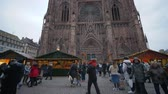admirado : STRASBOURG, FRANCE - DECEMBER 18, 2018: Christmas atmosphere, many admired tourists on fair site near Cathedrale Notre-Dame de Strasbourg