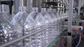 spill : Water factory, bottling pure spring water into plastic bottles at plant close-up Stock Footage
